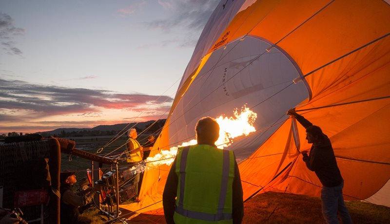 Inflating balloon and preparing for flight in the early morning