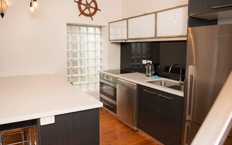 The kitchen is fully equipped with electric stove top and electric oven