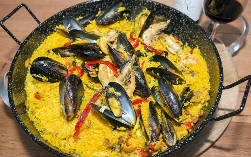 Paella with red wine