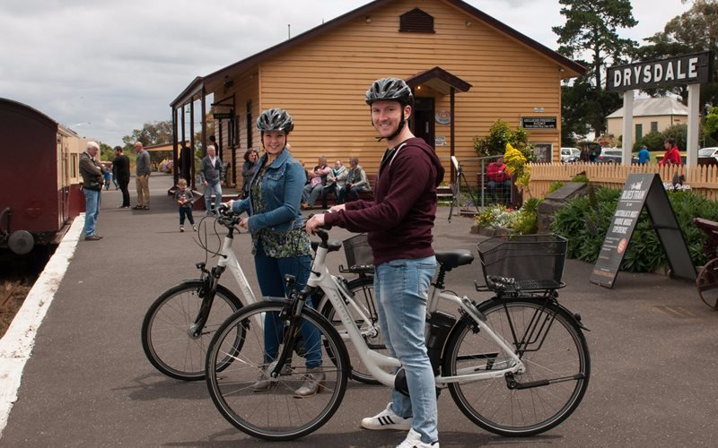 Riders on electric bikes  waiting for the train at Drysdale Station