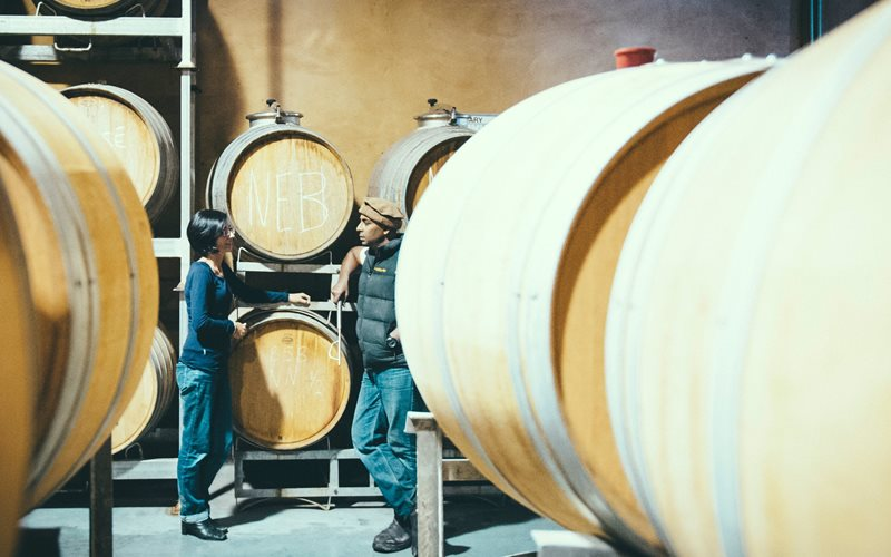 Maree & Ray discussing Nebbiolo in barrel in the winery